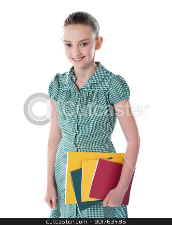 School girl carrying books in hand stock photo, School girl carrying books in hand isolated over white background by Ishay Botbol