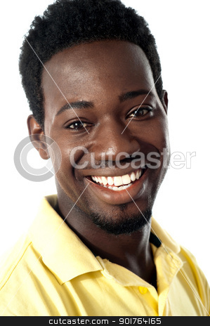 Closeup of smiling handsome african guy stock photo, Closeup shot of smiling handsome african guy by Ishay Botbol