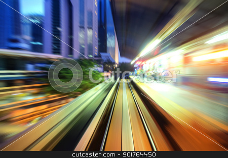 Speed trains passing train station stock photo, Speed trains passing train station. Focus on the rail road.   by szefei