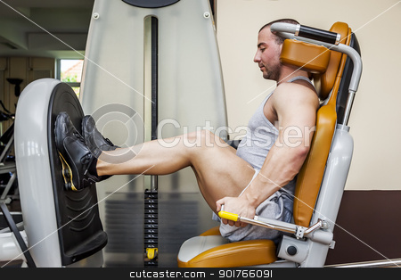 leg press stock photo, A handsome young muscular sports man doing leg press by Markus Gann