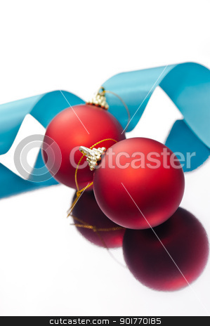 Christmas baubles and a blue ribbon stock photo, Red Christmas baubles and a blue ribbon on a silver reflective surface  by Ulrich Schade