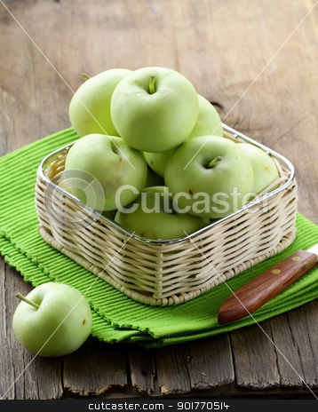 green ripe organic apples in the basket  stock photo, green ripe organic apples in the basket  by Olga Kriger
