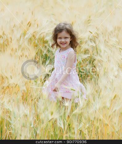 girl in a field stock photo, a little girl sing and dance in a field of rye by fogen