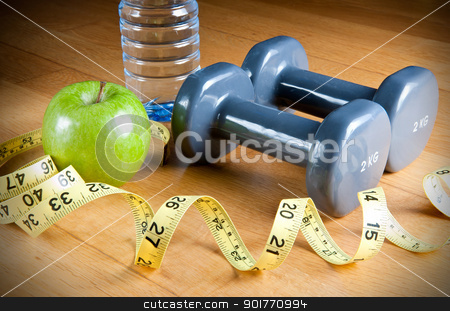 Exercise and Healthy Diet stock photo, Pair of dumbbells, green apple, measuring tape and bottle of water. Exercise and healthy diet concept. by ruigsantos