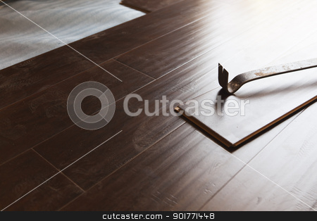 Pry Bar Tool with New Laminate Flooring stock photo, Pry Bar Tool with New Laminate Flooring Abstract. by Andy Dean