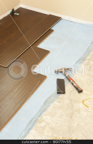 Hammer and Block with New Laminate Flooring stock photo, Hammer and Block with New Laminate Flooring Abstract. by Andy Dean
