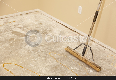 Concrete House Floor with Broom Ready for Flooring Installation stock photo, Blank Concrete House Floor with Broom Ready for Flooring Installation. by Andy Dean