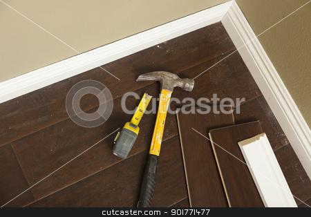 Hammer, Laminate Flooring and New Baseboard Molding stock photo, Hammer, Laminate Flooring and New Baseboard Molding Abstract. by Andy Dean
