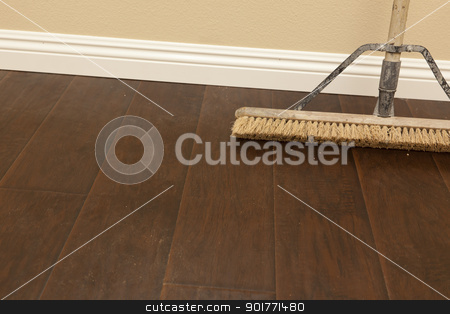 Push Broom on a Newly Installed Laminate Floor and Baseboard stock photo, Push Broom on a Newly Installed Laminate Floor and New Baseboards. by Andy Dean