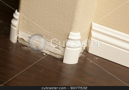 New Baseboard and Bull Nose Corners with Laminate Flooring stock photo, New Baseboard and Bull Nose Corners with Laminate Flooring Abstract. by Andy Dean