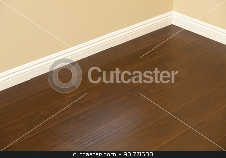 Newly Installed Brown Laminate Flooring and Baseboards in Home stock photo, Beautiful Newly Installed Brown Laminate Flooring and Baseboards in Home. by Andy Dean