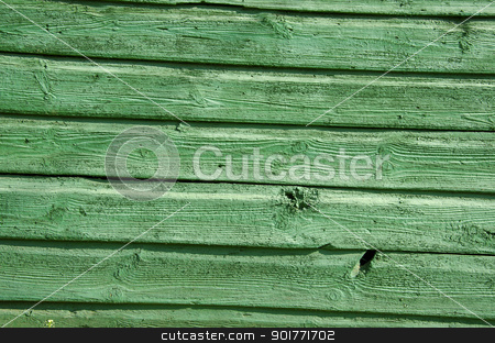 Background of old wooden board wall painted green  stock photo, Background of old wooden board wall painted green closeup.  by sauletas