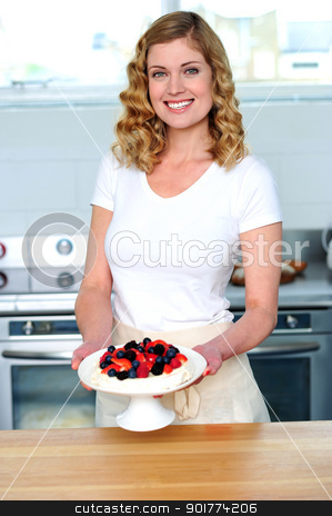 Attractive female presenting yummy treat stock photo, Attractive female presenting yummy treat. Holding bowl and smiling by Ishay Botbol