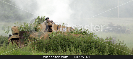 German officer comanding tank stock photo, German officer comands tank ss panzer division by Ollie Taylor