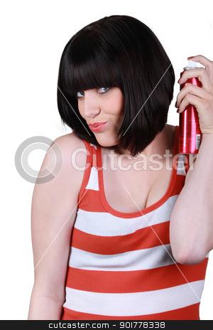 woman using hair spray stock photo, woman using hair spray by photography33