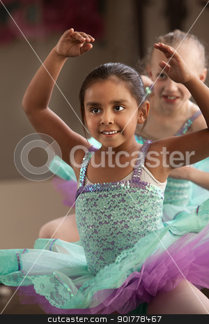 Children Dancing stock photo, Children in ballet dresses practice dance moves by Scott Griessel