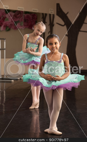 Cute Ballerinas Rehearsing stock photo, Two young ballet dresses rehearsing in a dance studio by Scott Griessel