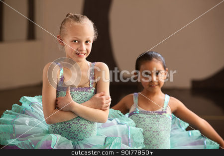 Young Ballerina Folds Her Arms stock photo, Young ballet student folding arms with friend nearby by Scott Griessel