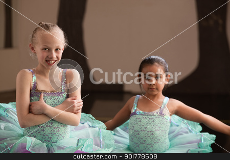 Smiling Pretty Ballet Girls stock photo, Cute smiling girls in pretty blue ballet dresses by Scott Griessel