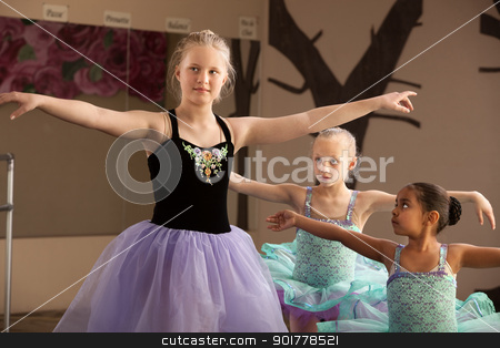 Ballet Students Practice Together stock photo, Young ballet students of different ages practicing together by Scott Griessel