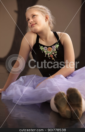 Carefree Ballet Student Sitting stock photo, Teen caucasian ballet student sits on the floor by Scott Griessel