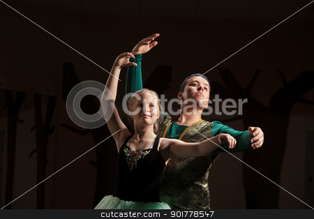 Dance Student Practices with Teacher stock photo, Young ballet student rehearsing with her teacher by Scott Griessel
