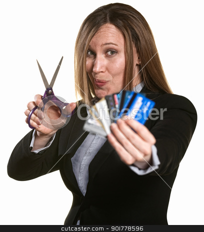 Woman Cuts Credit Cards stock photo, Businesswoman with scissors and stack of credit cards by Scott Griessel