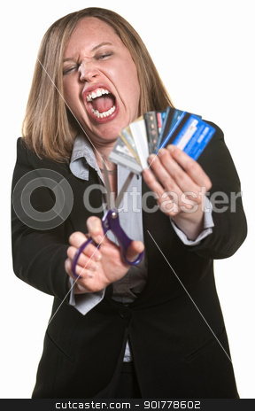 Angry Lady Cuts Credit Cards stock photo, Lady with scissors and credit cards over white background by Scott Griessel