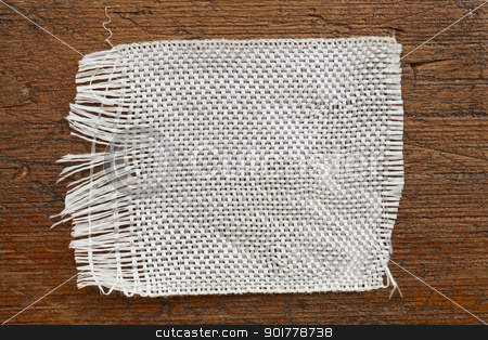 fiberglass cloth patch stock photo, a patch of  fiberglass cloth on a grunge wood background by Marek Uliasz