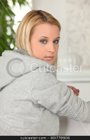 Woman wearing a sweater stock photo, Woman wearing a sweater by photography33