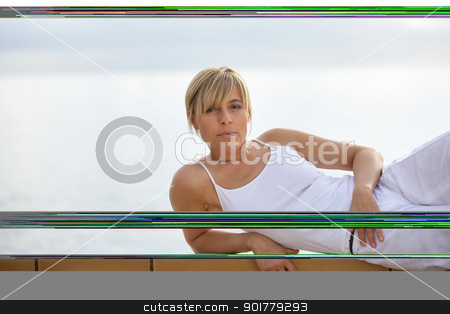 Woman performing yoga outdoors stock photo, Woman performing yoga outdoors by photography33