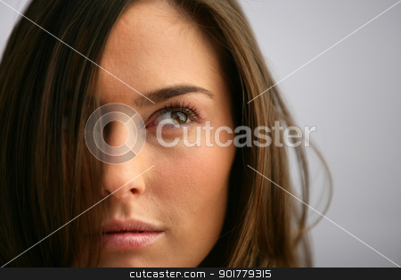 Sultry head-shot of brunette stood outdoors stock photo, Sultry head-shot of brunette stood outdoors by photography33