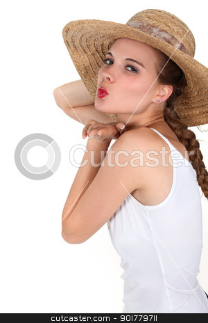 Beautiful young woman with straw hat and a long braid stock photo, Beautiful young woman with straw hat and a long braid by photography33