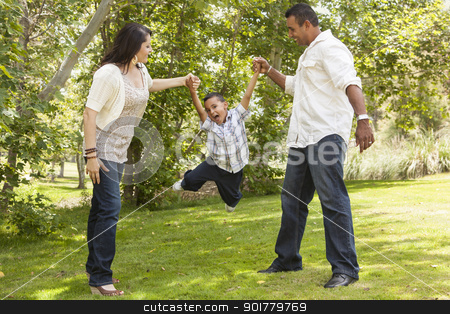 Hispanic Mother and Father Swinging Son in the Park stock photo, Happy Hispanic Mother and Father Swinging Son in the Park. by Andy Dean