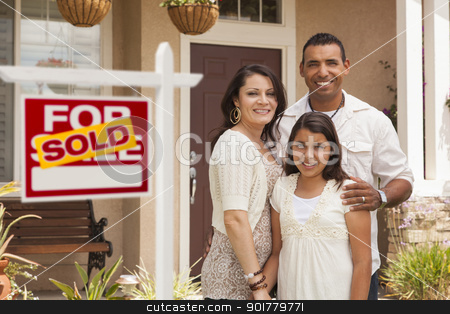 Hispanic Family in Front of Their New Home with Sold Sign stock photo, Hispanic Mother, Father and Daughter in Front of Their New Home with Sold Home For Sale Real Estate Sign. by Andy Dean