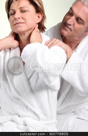 Husband giving wife neck massage stock photo, Husband giving wife neck massage by photography33
