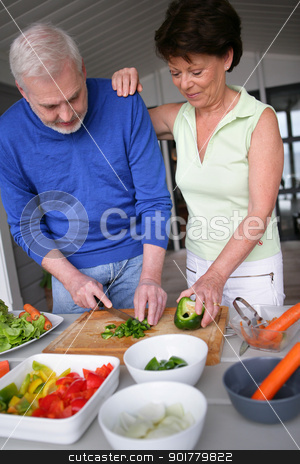 Older couple preparing a meal stock photo, Older couple preparing a meal by photography33