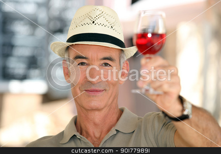 old man raising a glass of claret stock photo, old man raising a glass of claret by photography33