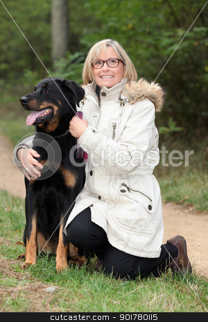 Woman walking her dog in the country stock photo, Woman walking her dog in the country by photography33