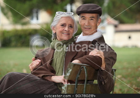 Elderly couple sat on a park bench stock photo, Elderly couple sat on a park bench by photography33