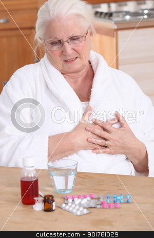 Elderly lady taking her medication stock photo, Elderly lady taking her medication by photography33
