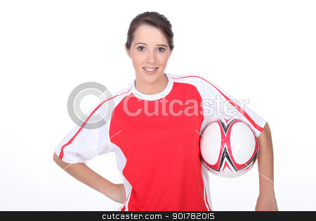 Girl holding football stock photo, Girl holding football by photography33