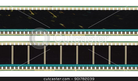 Film isolated stock photo, Long rows of old films are isolated from the background by Imaster