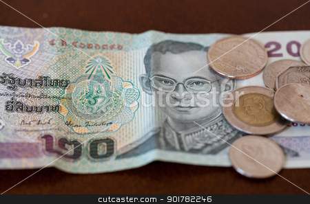 Twenty Baht note from Thailand with coins stock photo, Twenty baht note from Thailand with miscellaneous coins by Steven Heap