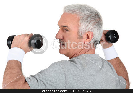 Man working out with dumbbells stock photo, Man working out with dumbbells by photography33