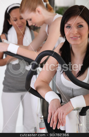 Woman exercising at the gym stock photo, Woman exercising at the gym by photography33