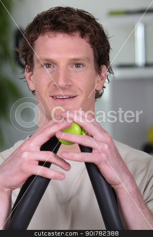 Man using a resistance exerciser stock photo, Man using a resistance exerciser by photography33