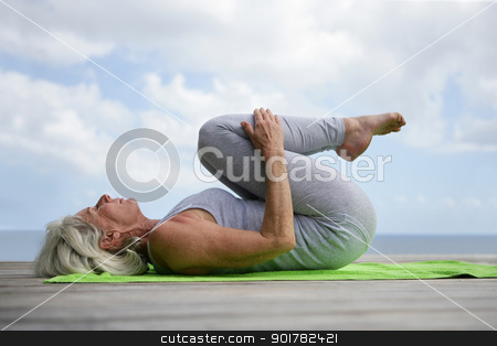 Woman doing yoga on jetty stock photo, Woman doing yoga on jetty by photography33