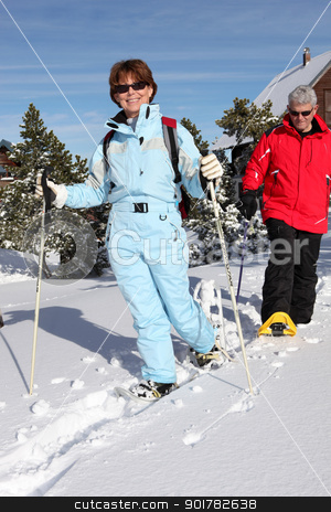 Middle-aged couple skiing to stay fit stock photo, Middle-aged couple skiing to stay fit by photography33