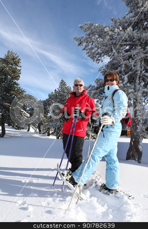 Older couple cross country skiing stock photo, Older couple cross country skiing by photography33